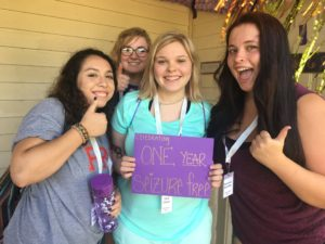 Group of girls at summer camp celebrating one year of being seizure free.
