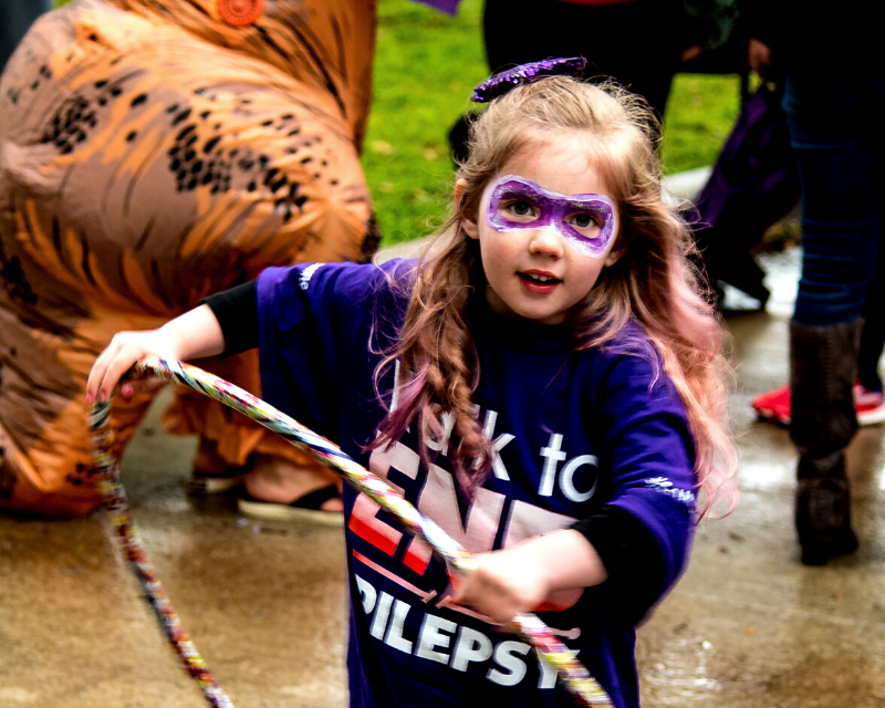 Little girl superhero hula hooping at the 2019 Walk to END EPILEPSY