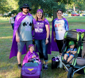 Superhero family at the Walk to END EPILEPSY. They walk to support research for their young daughter with epilepsy.