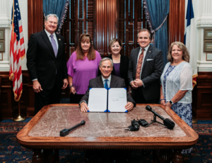 Sam's Law being signed into law at Governor Greg Abbott's desk.