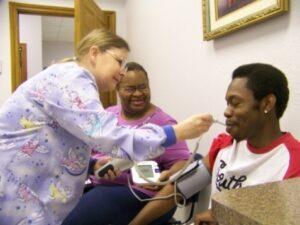 Nurse taking patient's temperature